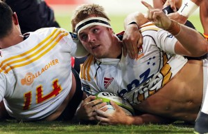 Chiefs co-captain Sam Cane celebrates scores a try