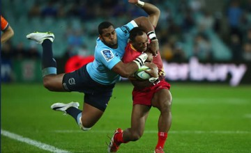 Chris Kuridrani is tackled in the last Reds Waratahs clash