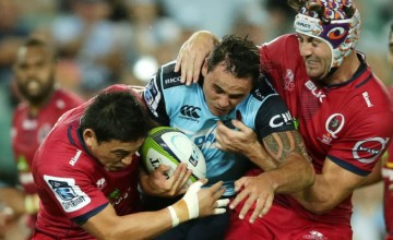 Ayumu Goromaru tackles Zac Guildford of the Waratahs