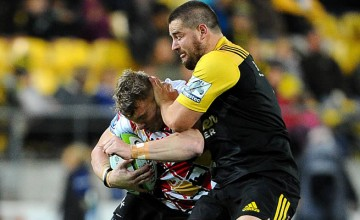 Dane Coles tackles Chris Cloete of the Southern Kings