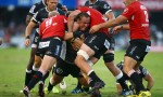 Coenie Oosthuizen gets wrapped up by the Lions defence
