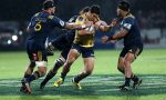 Matt Toomua gets wrapped up in the Highlanders defence