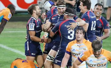 The Melbourne Rebels celebrate a try scored against the Cheetahs