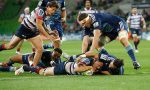 Scott Higginbotham scores a try against the Blues for the Rebels