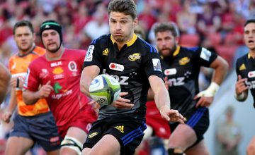 Beauden Barrett passes the ball for the Hurricanes against the Reds