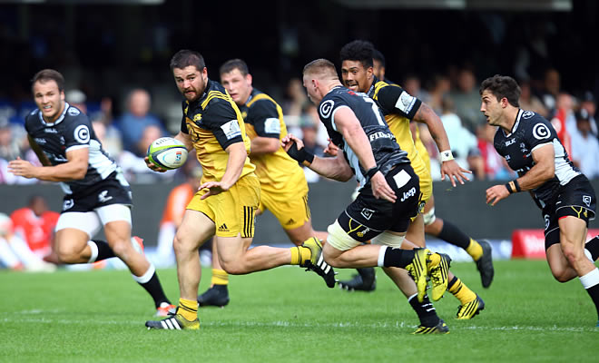 Dane Coles (c) of the Hurricanes on attack