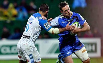 Dane Haylett-Petty tussles with Billy Guyton of the Blues