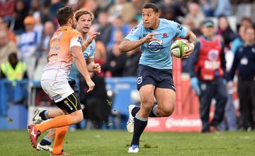 Israel Folau fends off a Cheetahs tackle