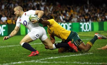 Australia's Tevita Kuridrani tackles Mike Brown