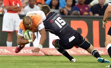 Cornal Hendricks is tackled by the Sharks