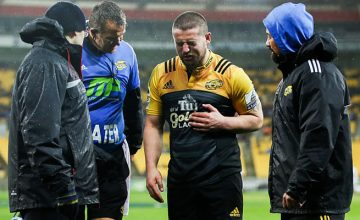 Dane Coles leaves the field injured against the Sharks