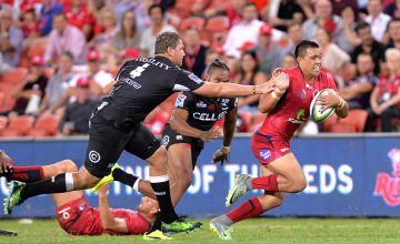 Reds player Duncan Paia'aua breaks away from t