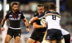 Coenie Oosthuizen of the Sharks is tackled during the round two Super Rugby match
