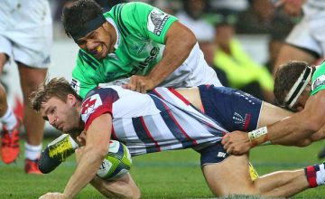 Dom Shipperley of the Rebels is tackled by Shane Christie