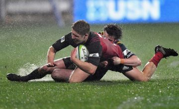 Jack Goodhue of the Crusaders is tackled by Richard Buckman of the Highlanders during the Super Rugby Quarter Final