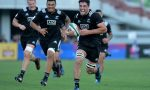 Luke Jacobson of New Zealand breaks free to score