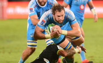 RG Snyman of the Bulls tackled by TJ Perenara of the Hurricanes during the Super Rugby match between Bulls and Hurricanes at Loftus Versfeld Stadium