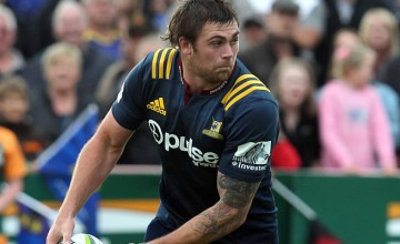Liam Squire with the ball in a Super Rugby warm up match