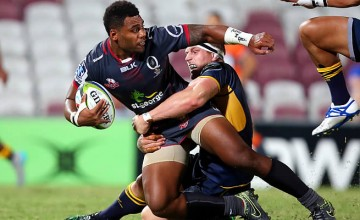 Samu Kerevi of the Reds is tackled by David Pocock