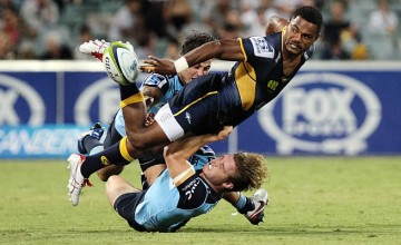 Henry Speight gets the ball away in a double tackle