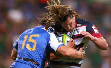 Jordy Reid defends the ball for the Rebels