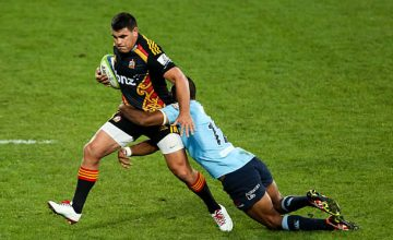 Dwayne Sweeney tries to get away from the Waratahs for the Chiefs in 2014