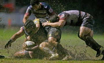 Fereti Sa'aga of the Rebels is tackled during the Super Rugby Exhibition match between the Rebels and the Hurricanes