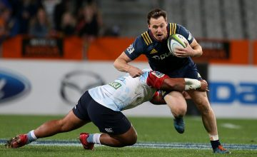 Ben Smith of the Highlanders tries to break a tackle