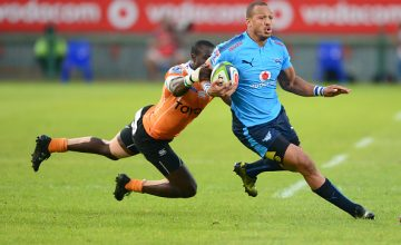 Raymond Rhule of the Cheetahs tackles Travis Ismaiel of the Bulls during the Super Rugby match