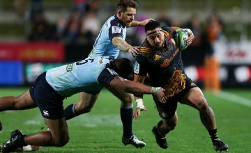 Kane Hames of the Chiefs attempts to beat the defence of Will Skelton and Bernard Foley
