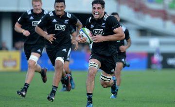 Luke Jacobson of New Zealand breaks free to score