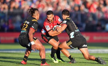Richie Mo'unga of the Crusaders charges forward during the round two Super Rugby match between the Crusaders and the Chiefs