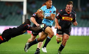 Israel Folau of the Waratahs is tackled during the round two Super Rugby match between the Waratahs and the Stormers at Allianz Stadium