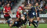 Mitchell Drummond of the Crusaders looks to offload during the round five Super Rugby match between the Highlanders and the Crusaders at Forsyth Barr Stadium